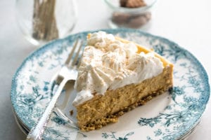 a slice of pumpkin spice cheesecake