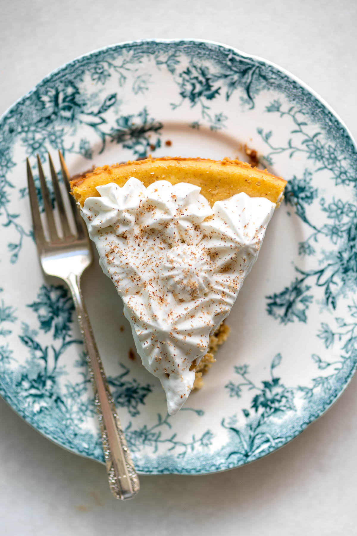 pumpkin cheesecake with piped whipped cream topping
