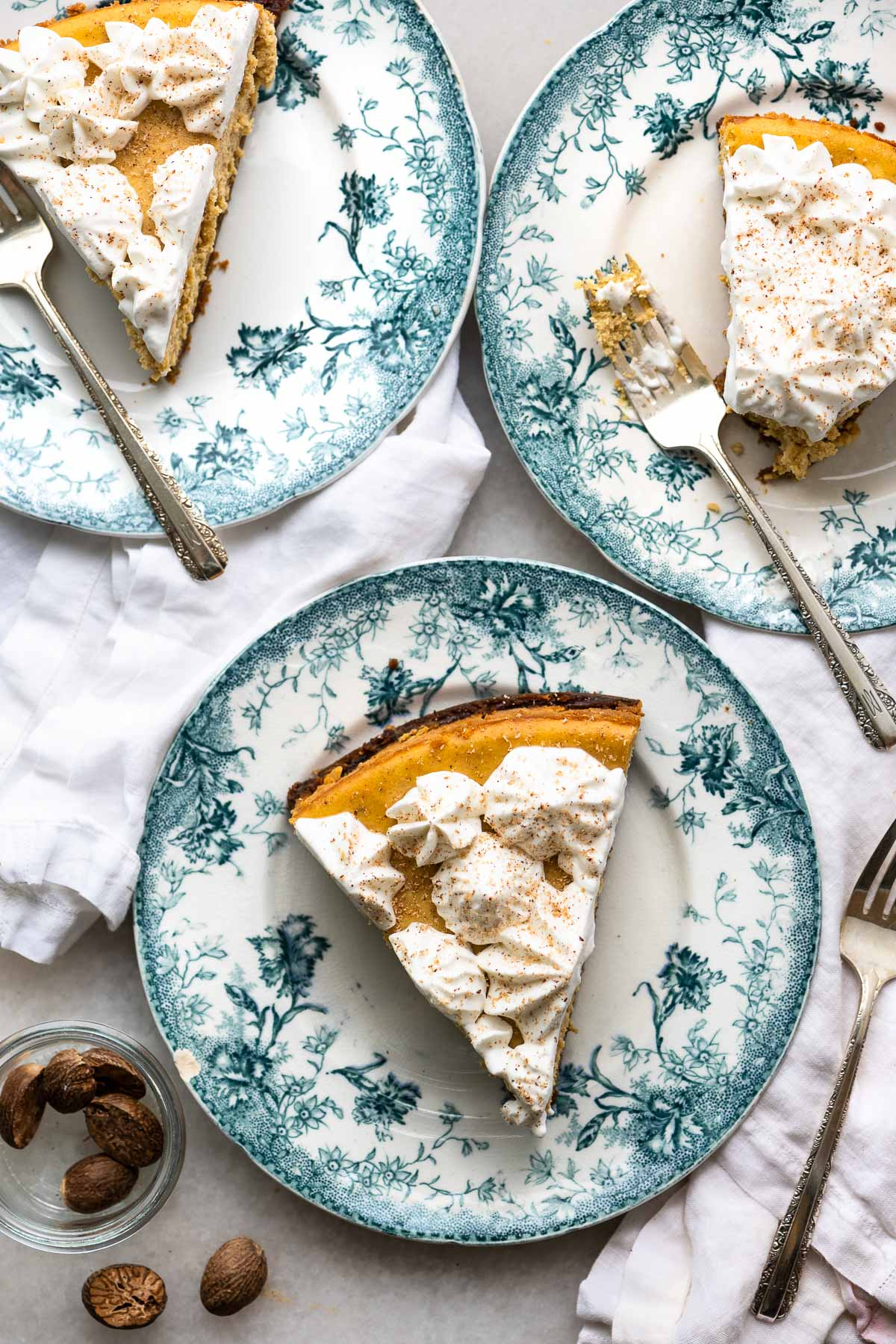 slices of pumpkin cheesecake on blue floral plates