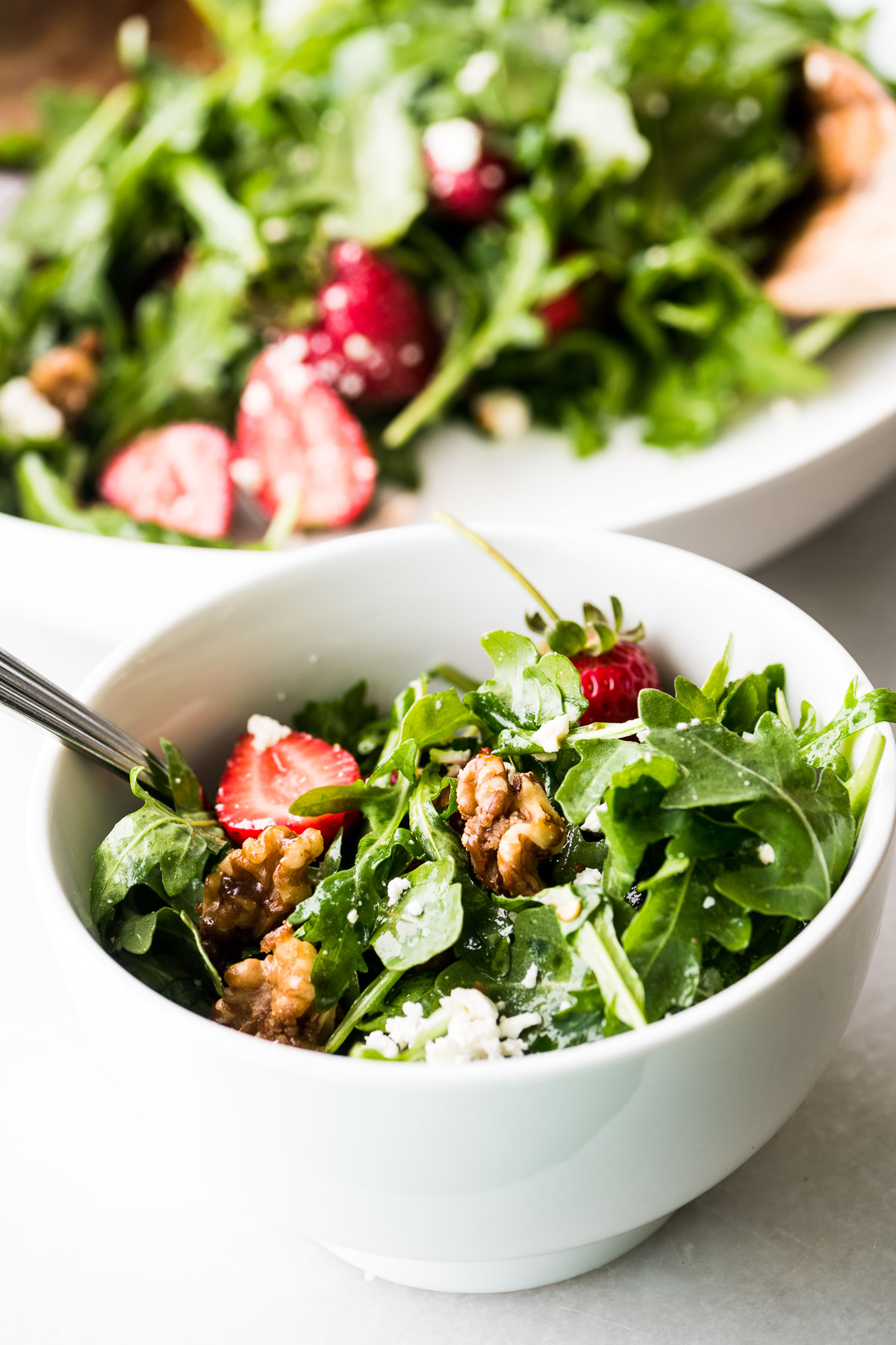 strawberry salad in a small white bowl
