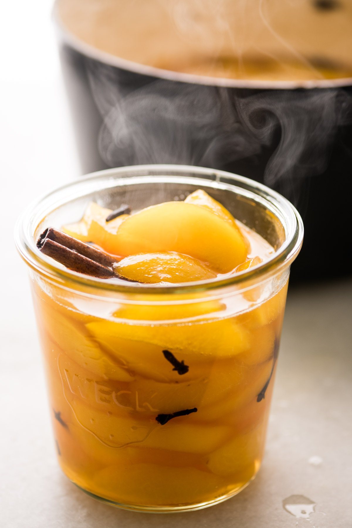 old fashioned spiced peaches in a canning jar