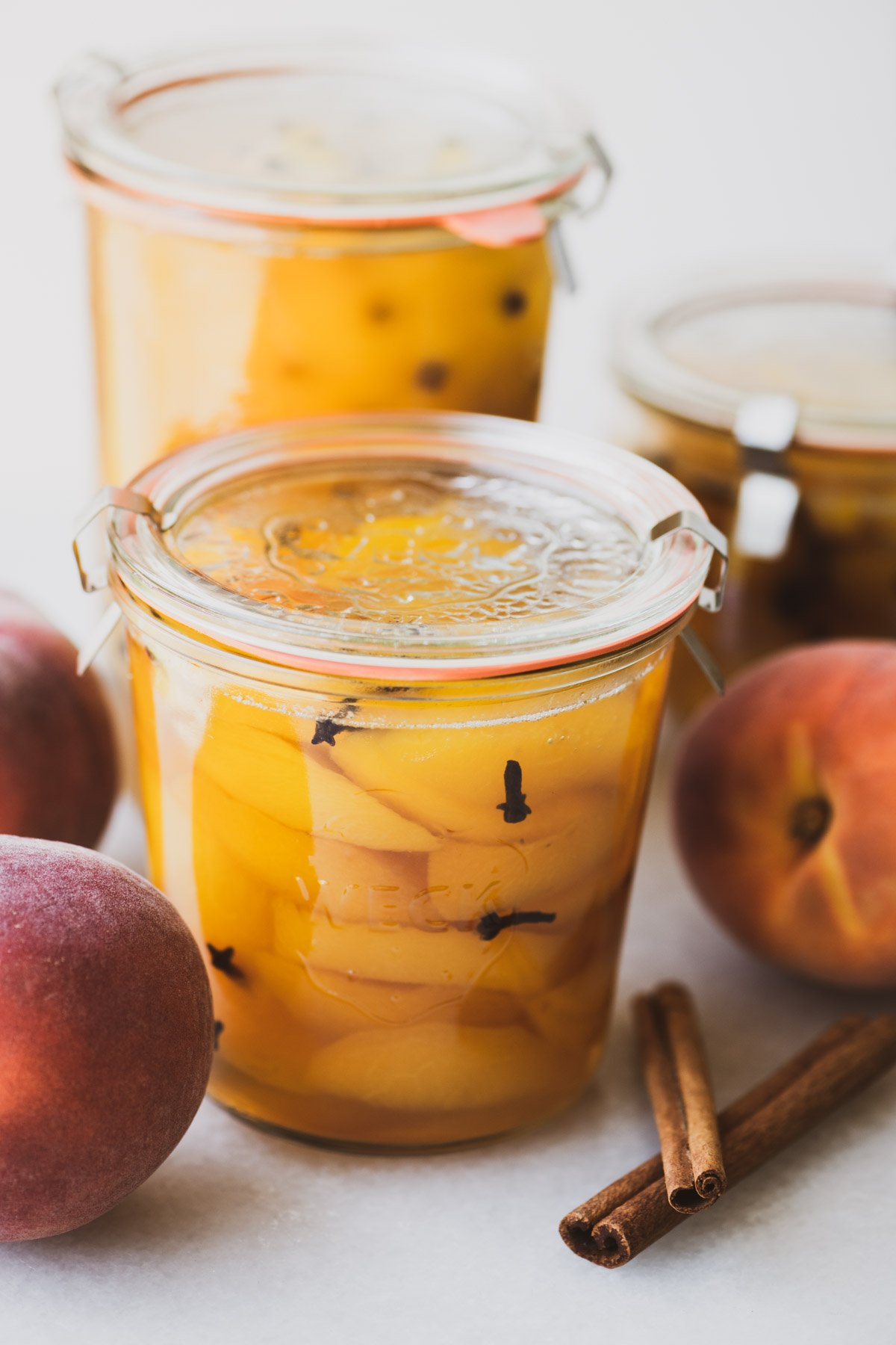 old fashioned spiced peaches, in glass canning jars