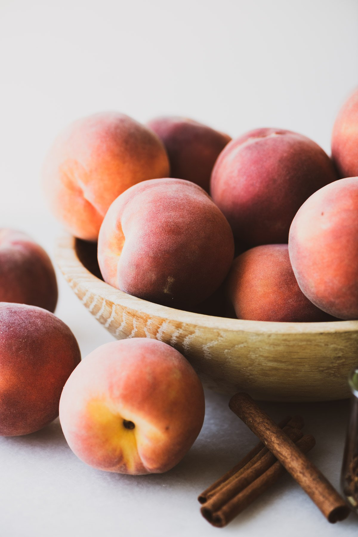 fresh peaches in a wooden bowl
