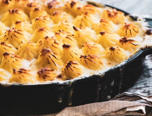 fish pie in a casserole dish with piped mashed potato crust
