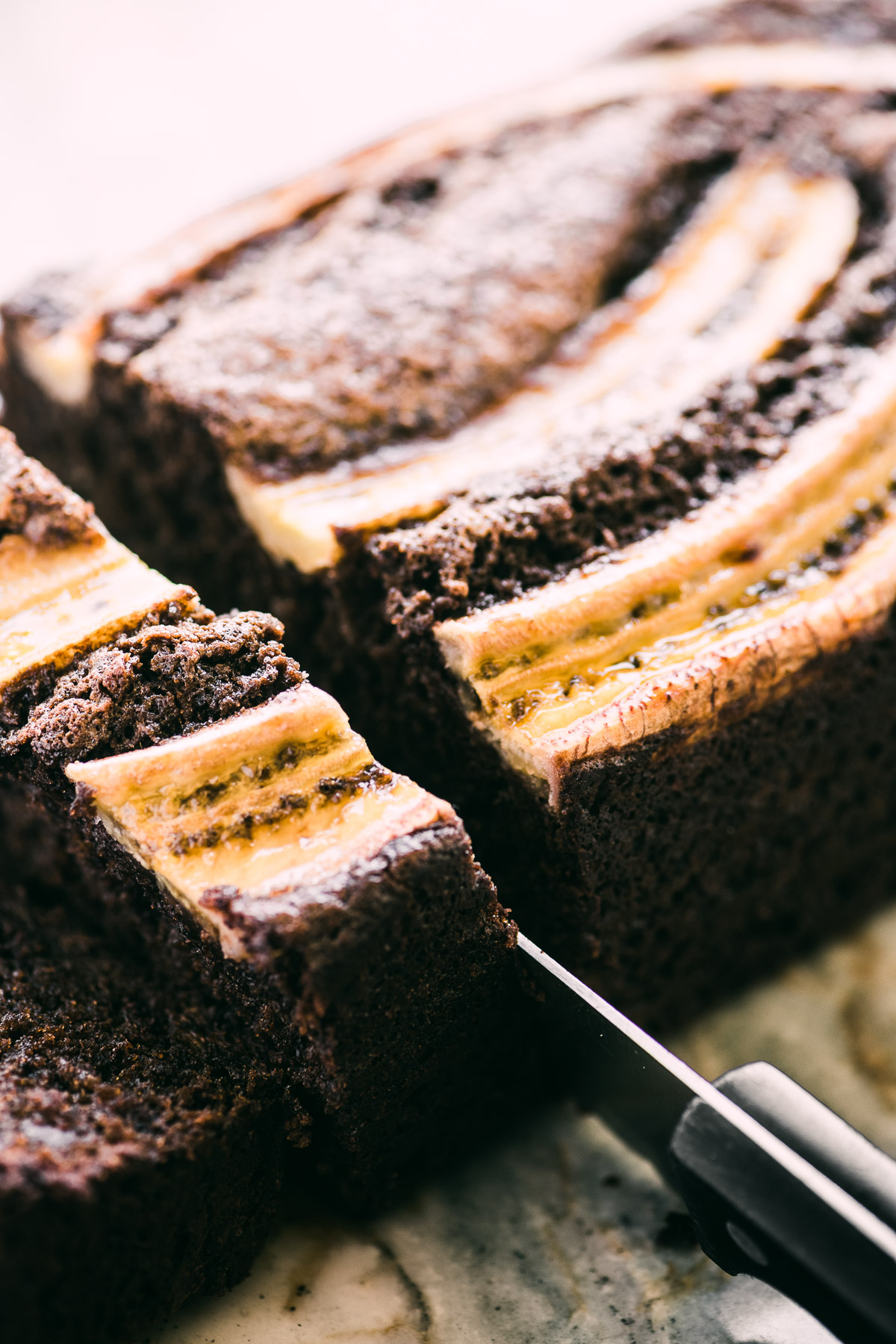 double chocolate banana bread, being sliced
