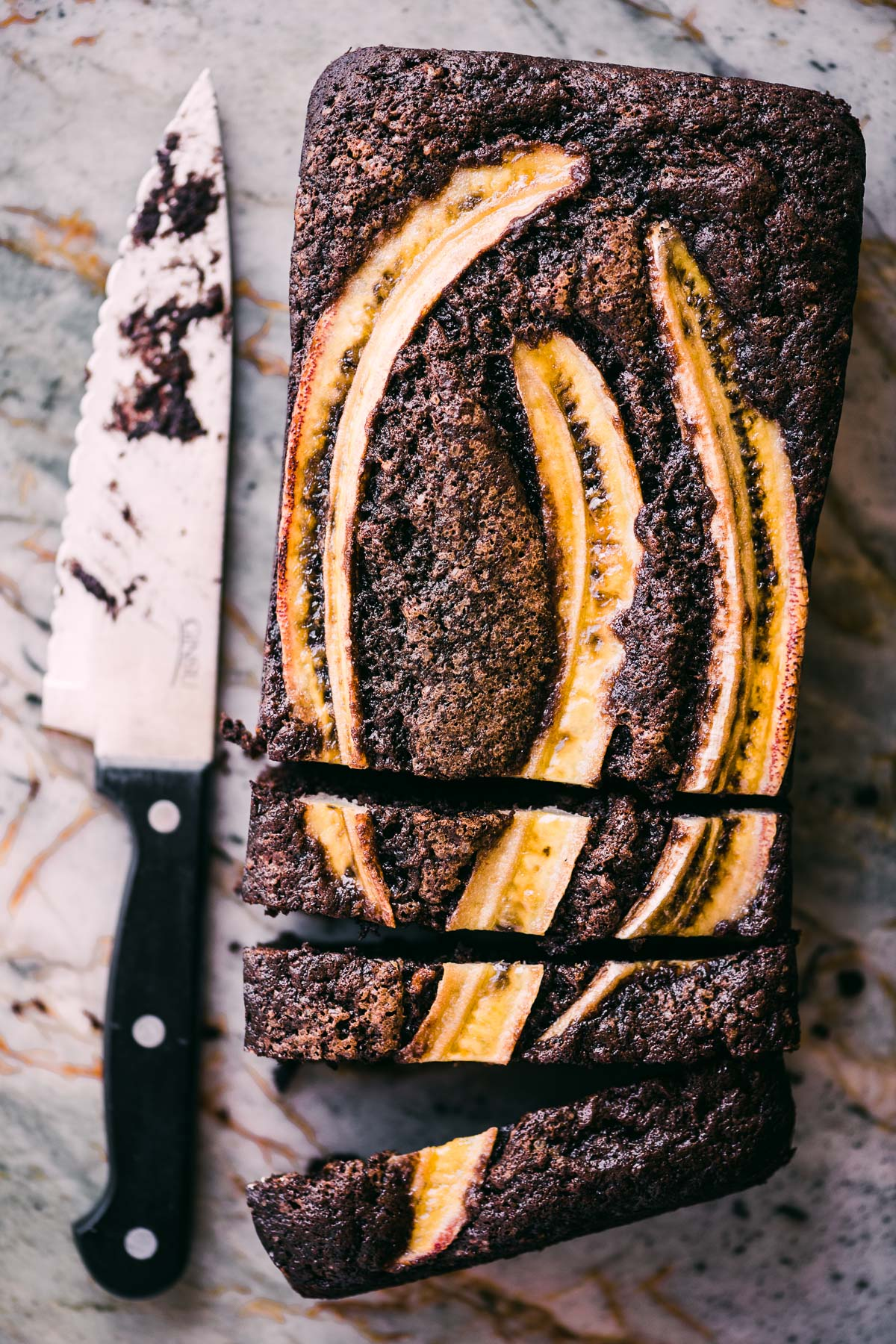 loaf of double chocolate banana bread with knife