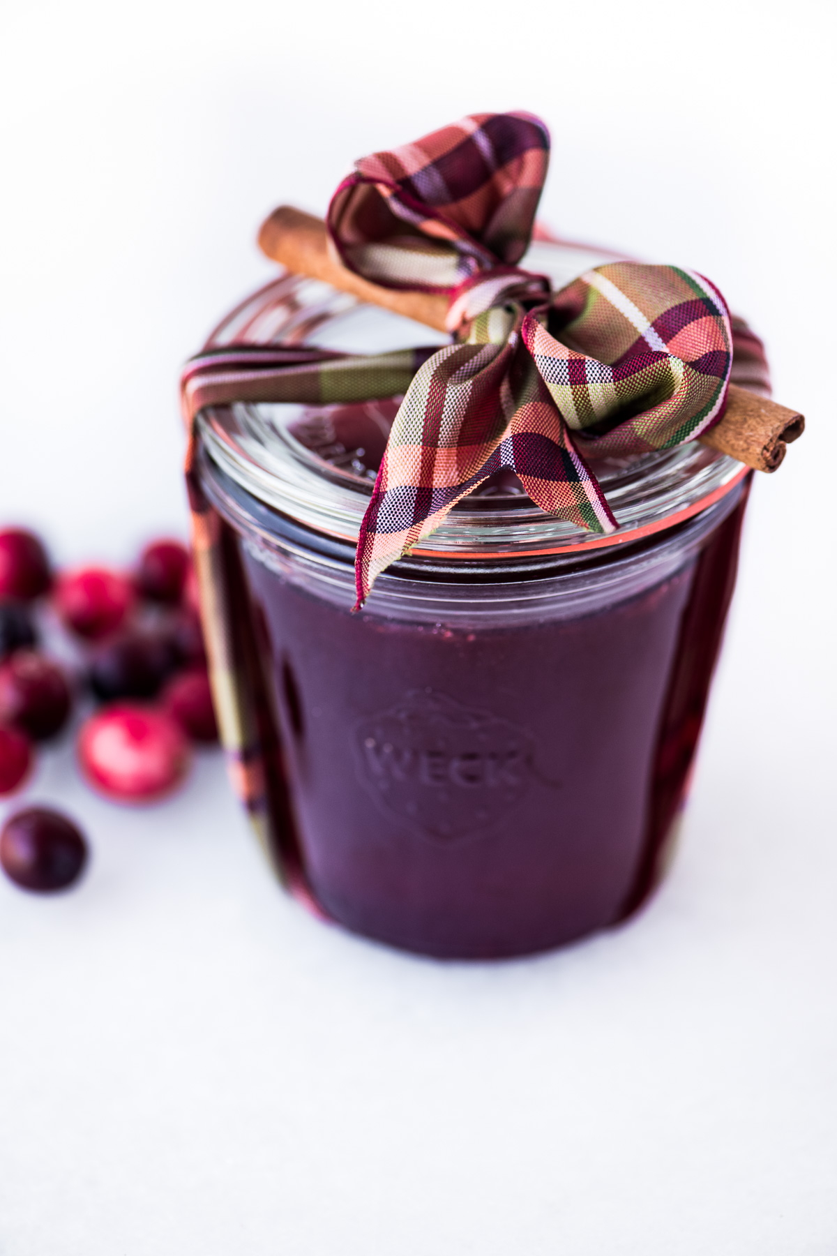mulled cranberry jelly in a jar with bow