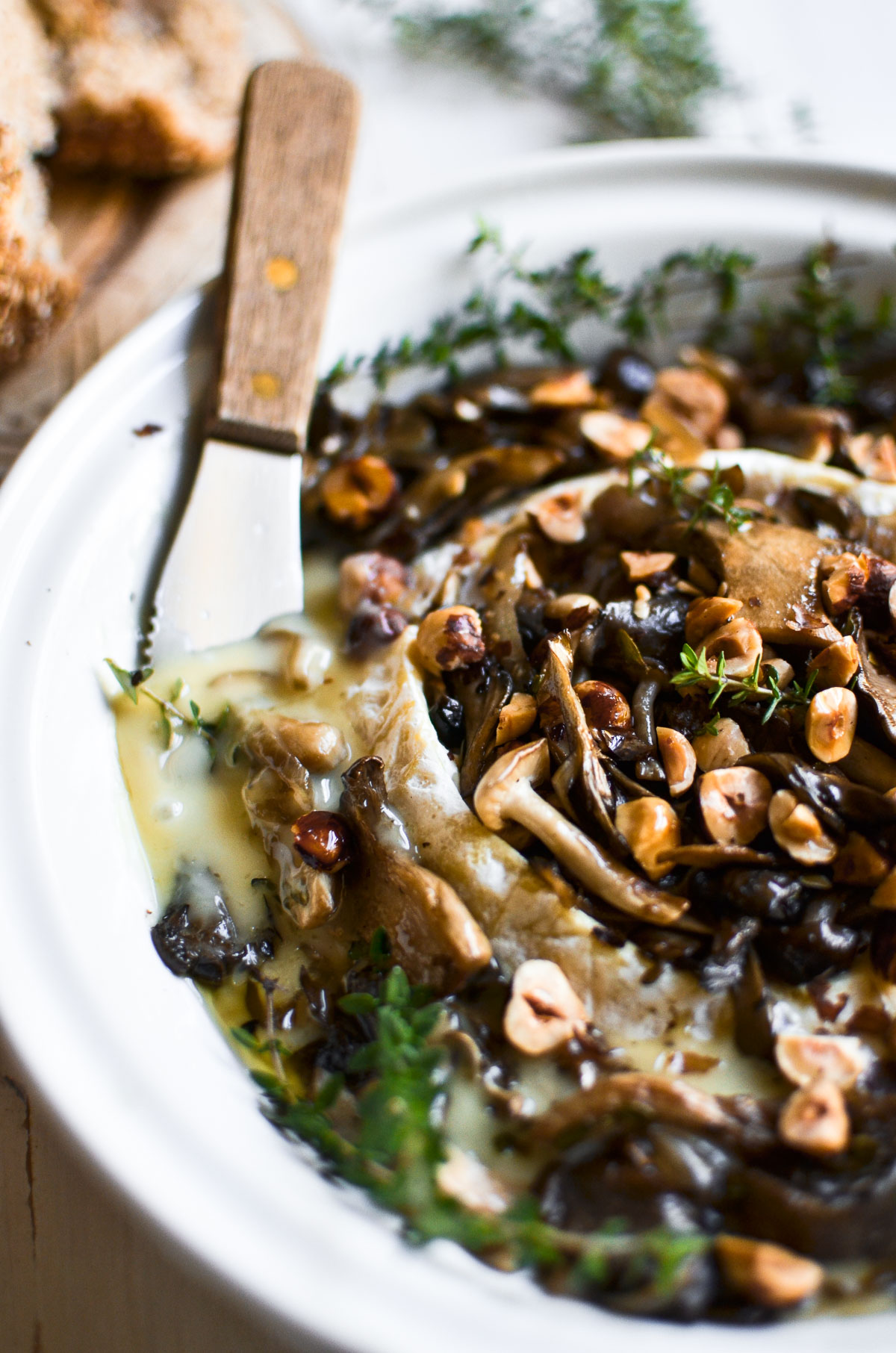 baked brie with mushrooms and hazelnuts