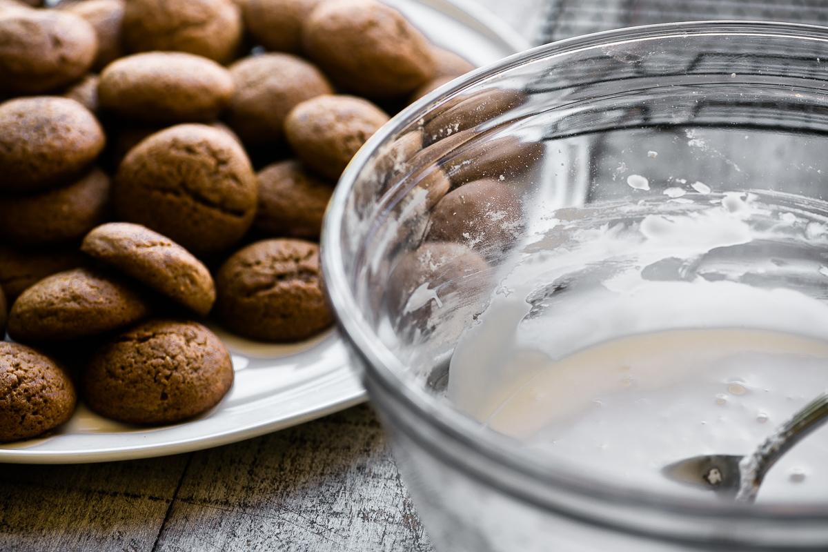 pfeffernusse cookies waiting to be glazed