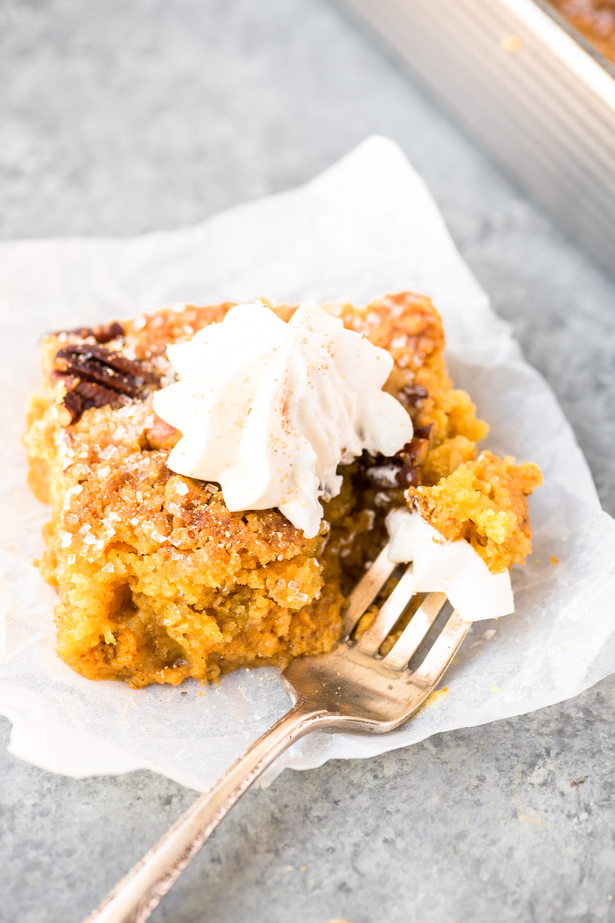 pumpkin crunch cake with maple nutmeg whipped cream