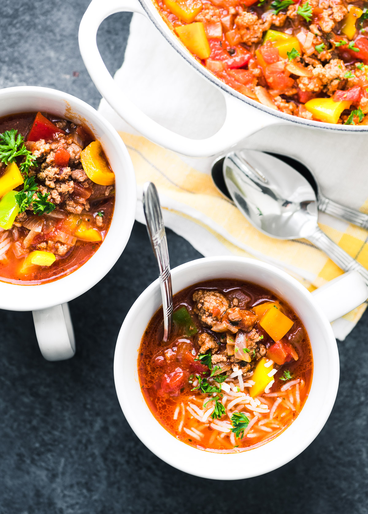 stuffed pepper soup in white mugs with spoons
