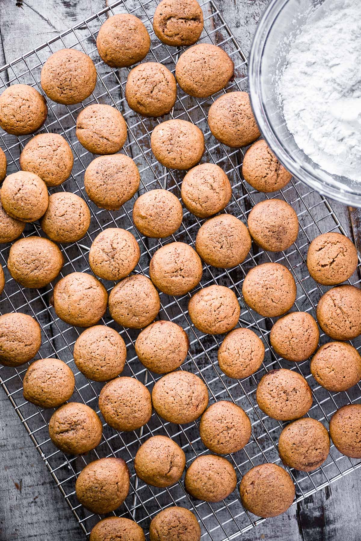 pfeffernusse cookies on a cooling rack