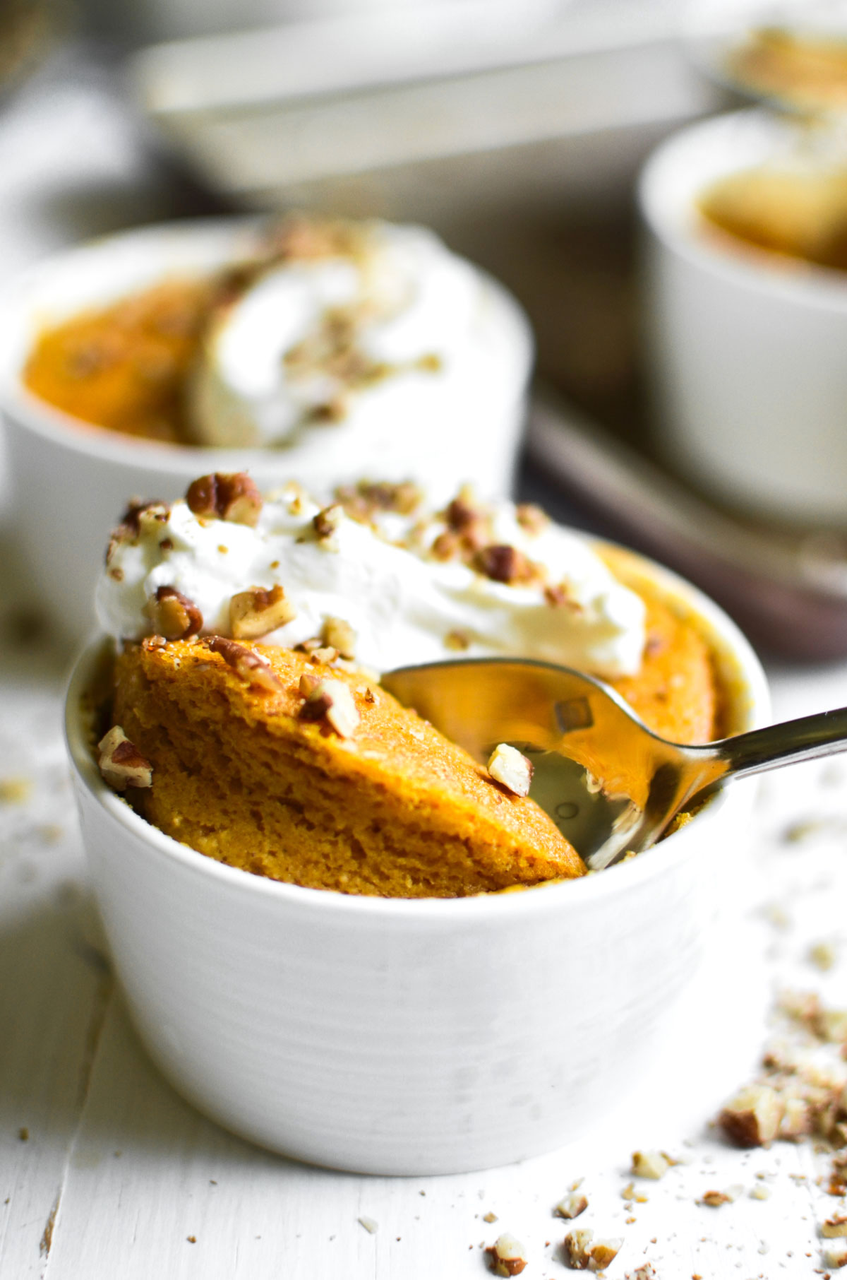 warm pumpkin pudding cakes with spoon
