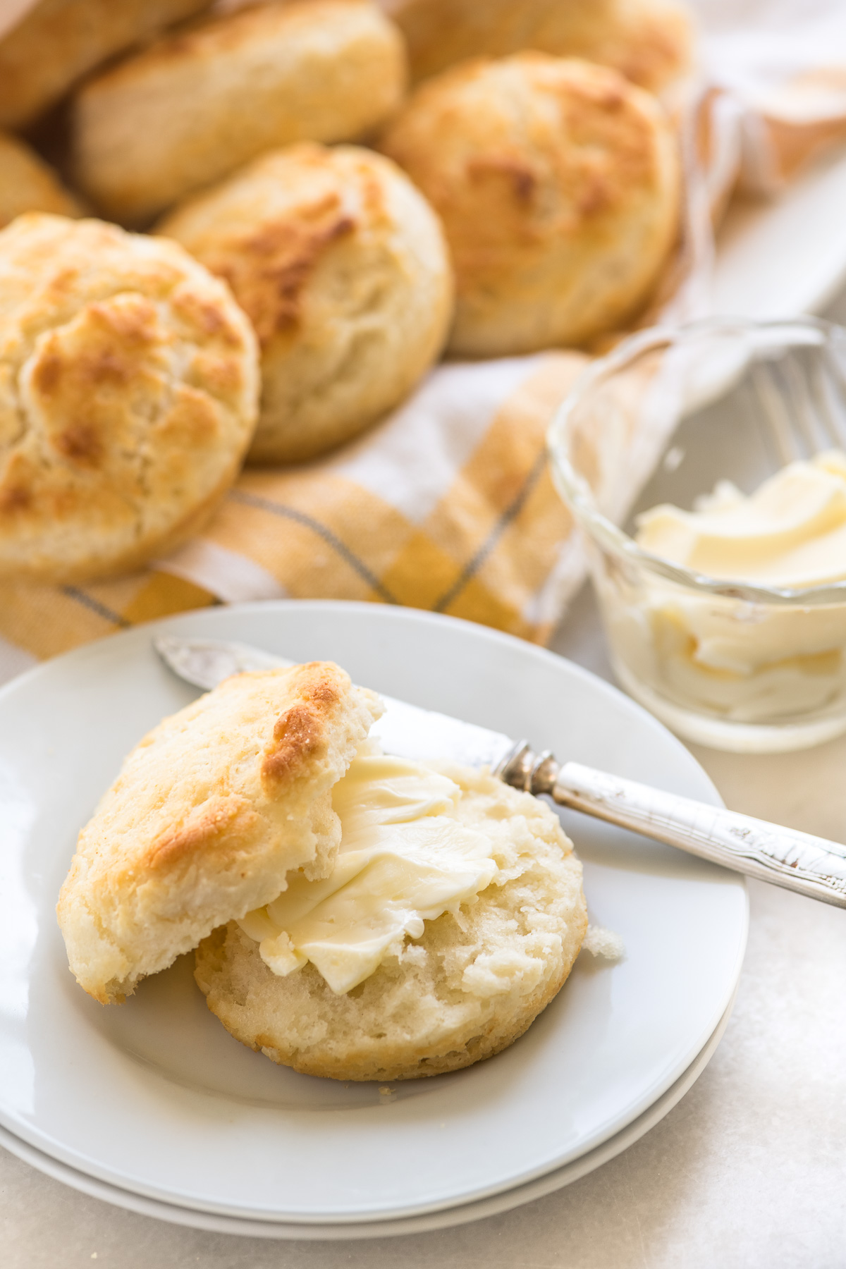 A plate of biscuits with butter