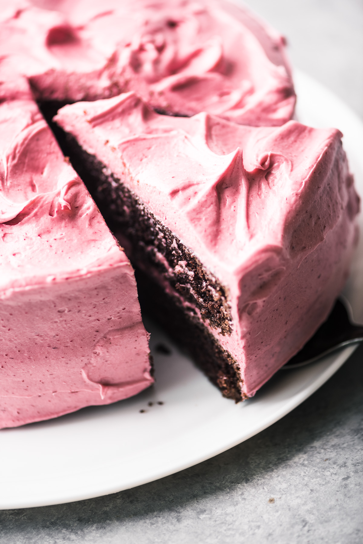 serving chocolate cake with cranberry buttercream