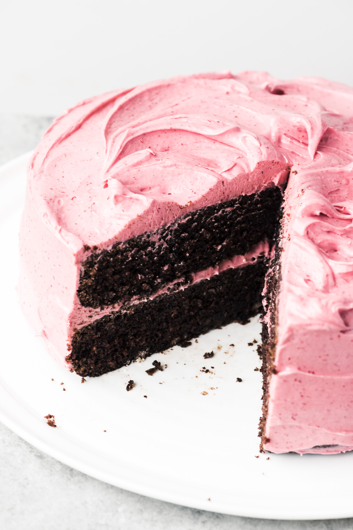 sliced chocolate cake with cranberry frosting
