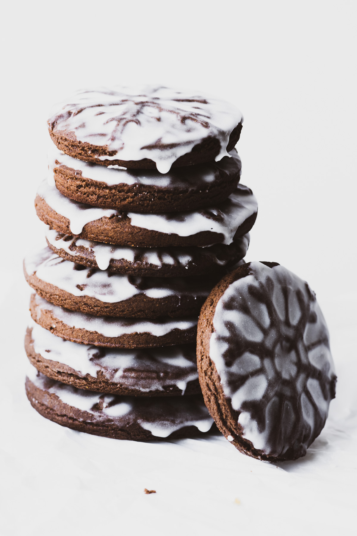 a stack of chocolate stamped gingerbread cookies