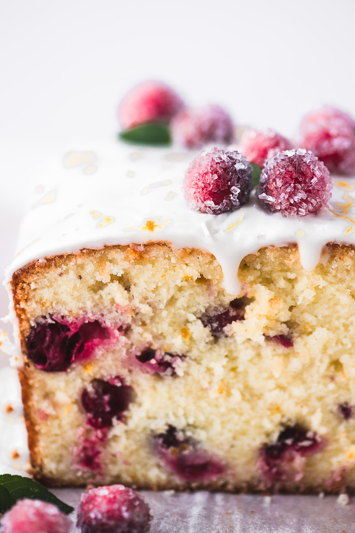 cranberry orange bread topped with sugared cranberries