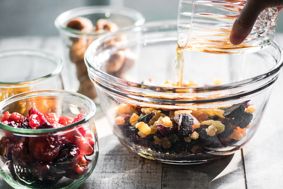 Adding brandy and Amaretto to dried fruit