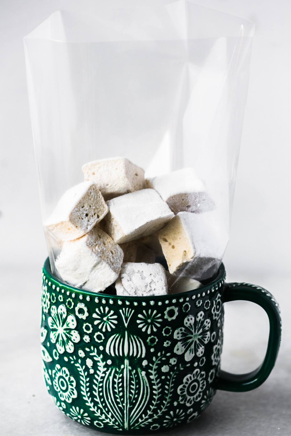 maple marshmallows in a cellophane bag in mug