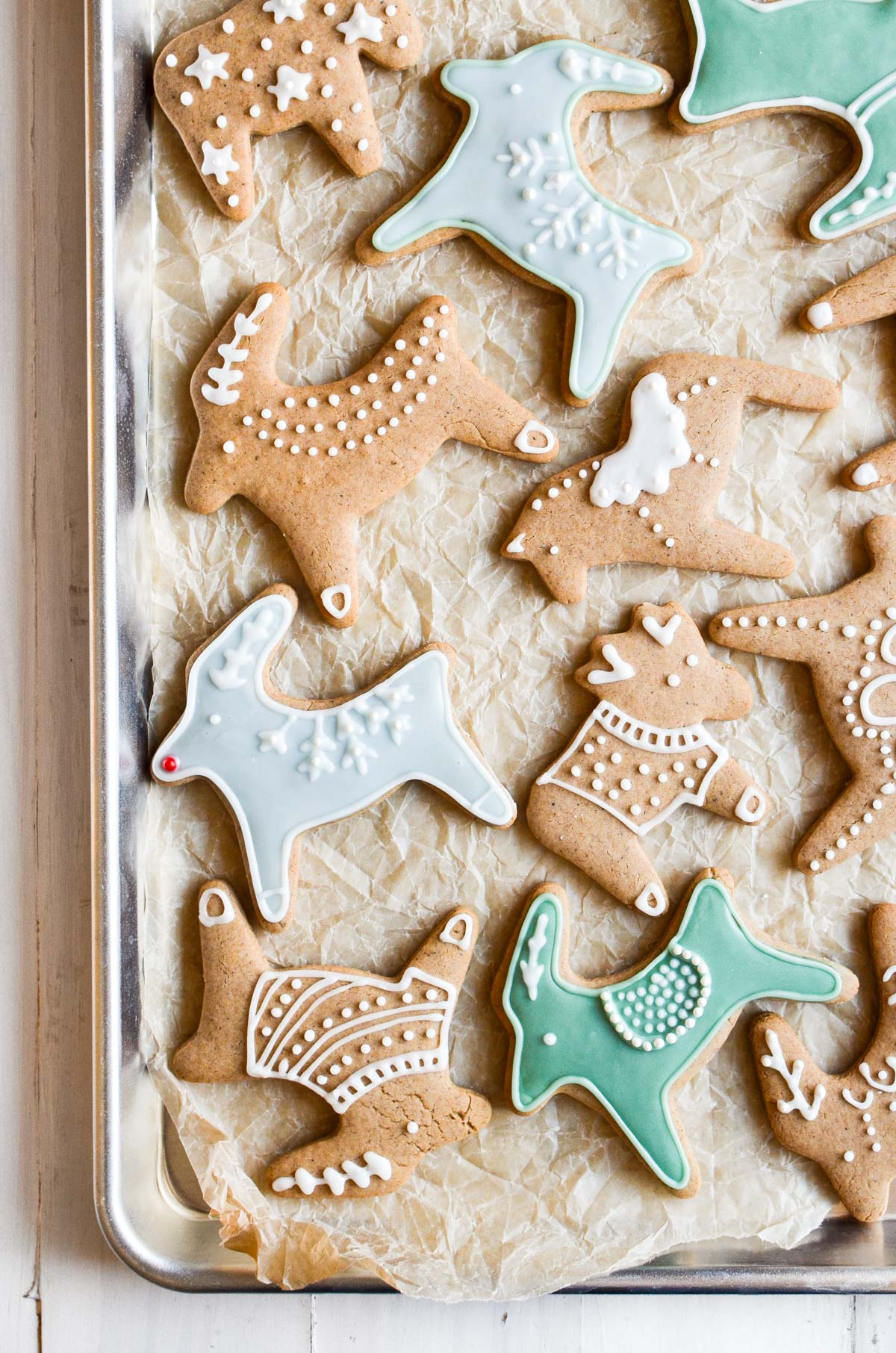 Decorated Pepparkakor Cookies on a baking sheet lined with parchment paper.
