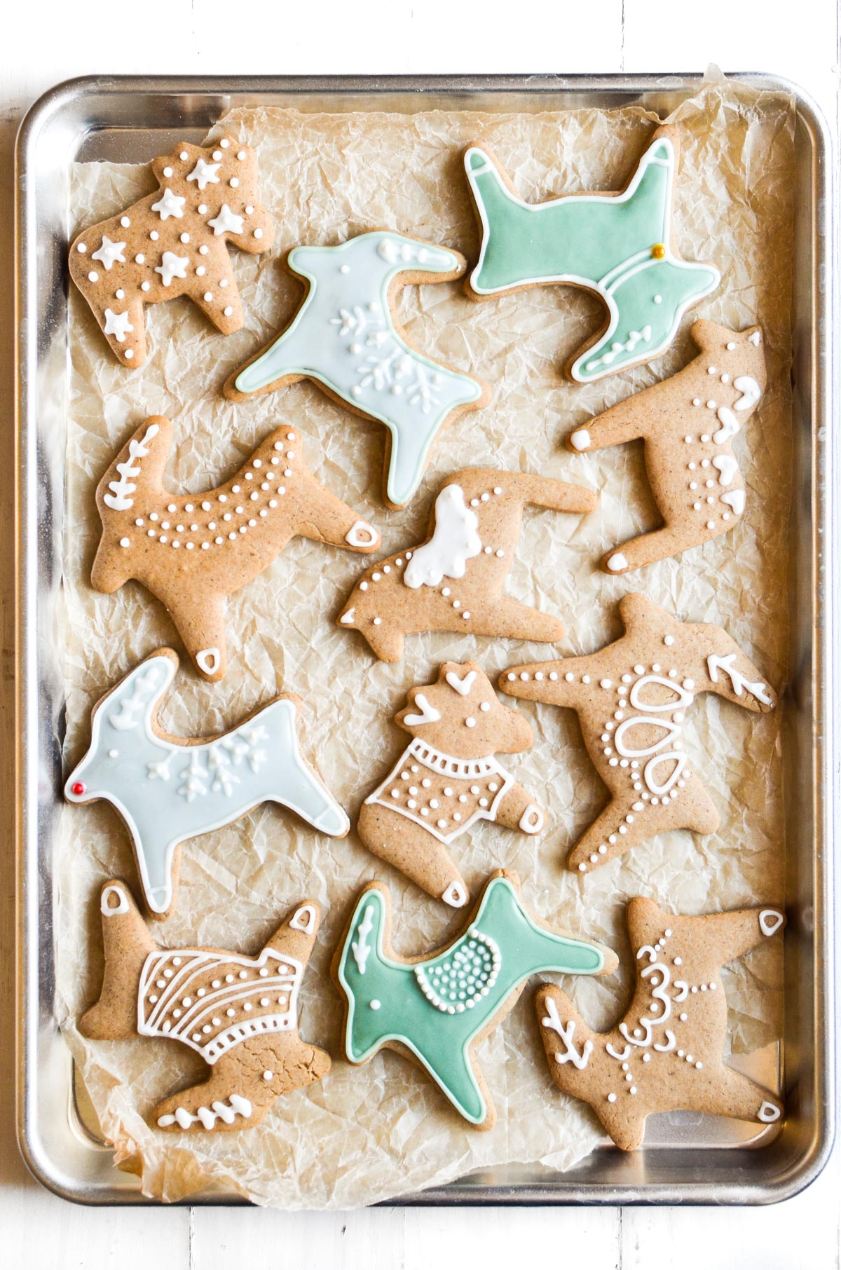 Decorated pepparkakor cookies on a baking sheet.