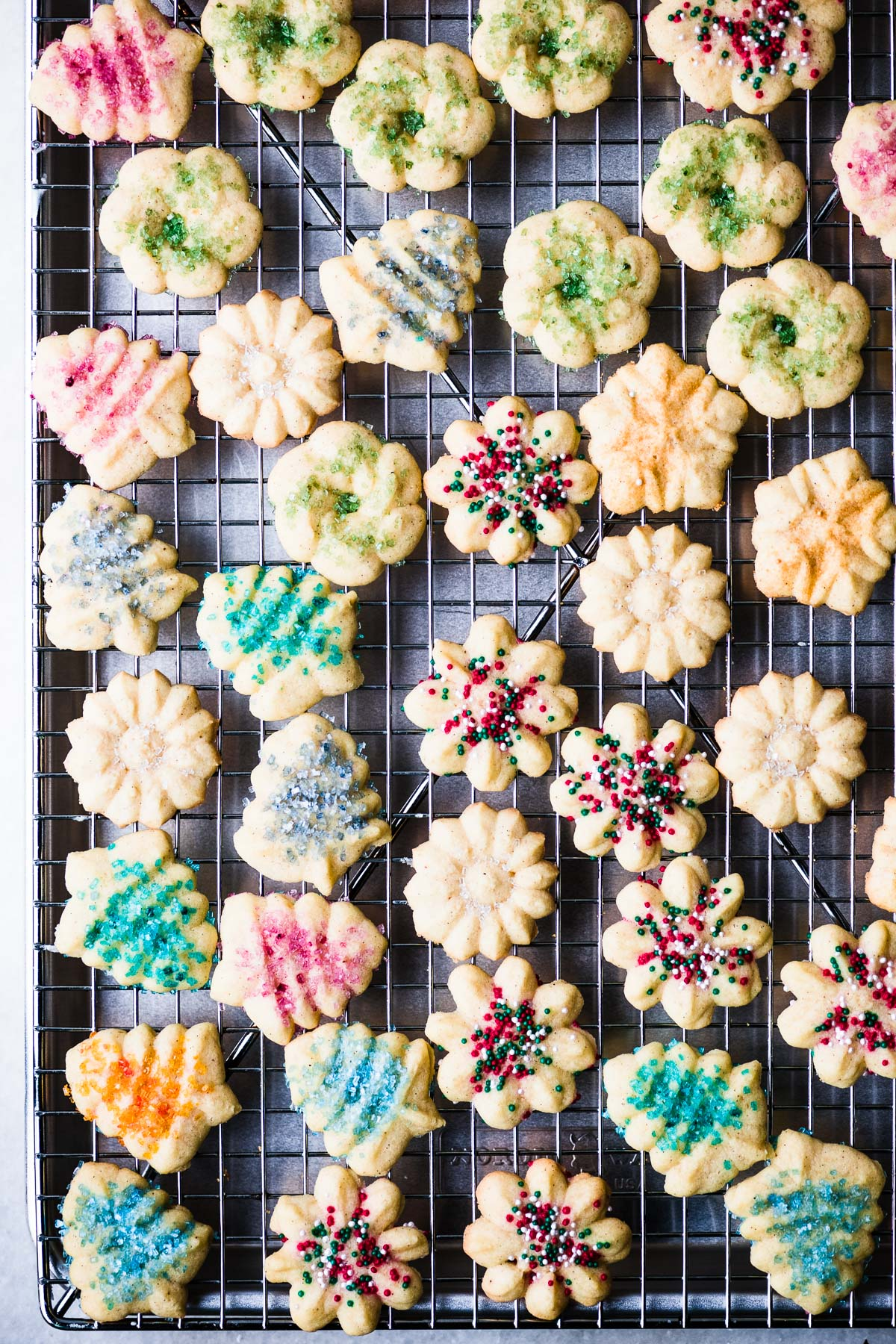 colorful spritz cookies on a cooling rack