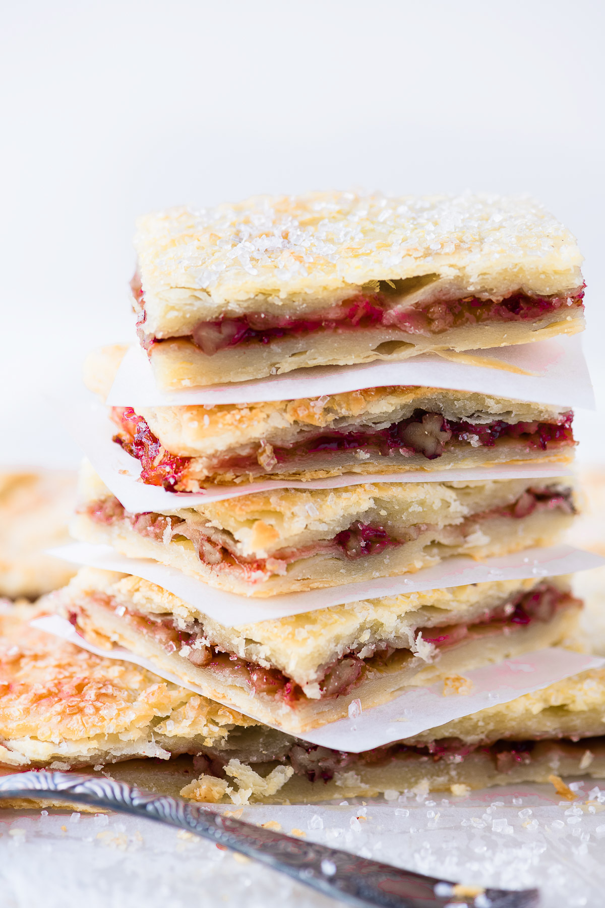 a stack of jam rugelach bars