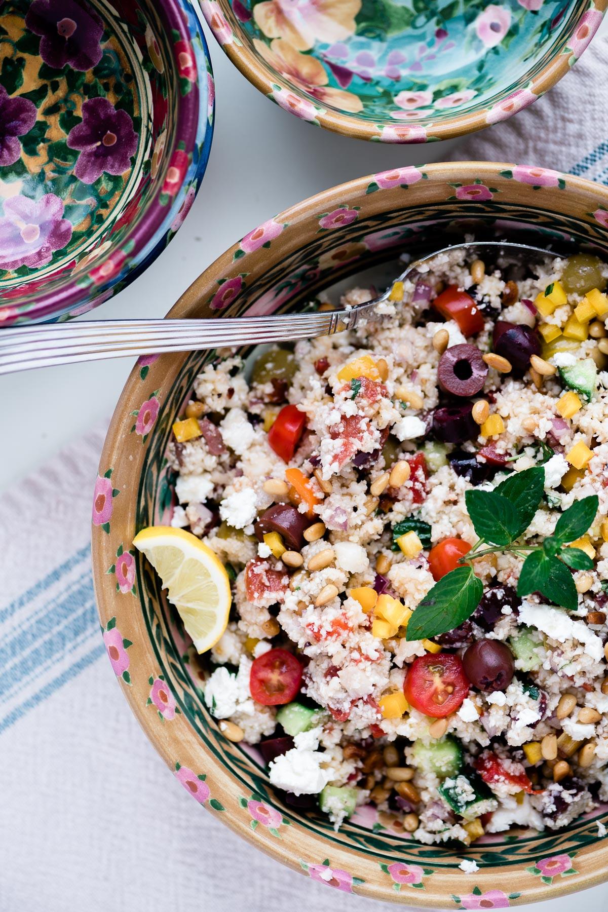 cauliflower couscous salad in floral bowls