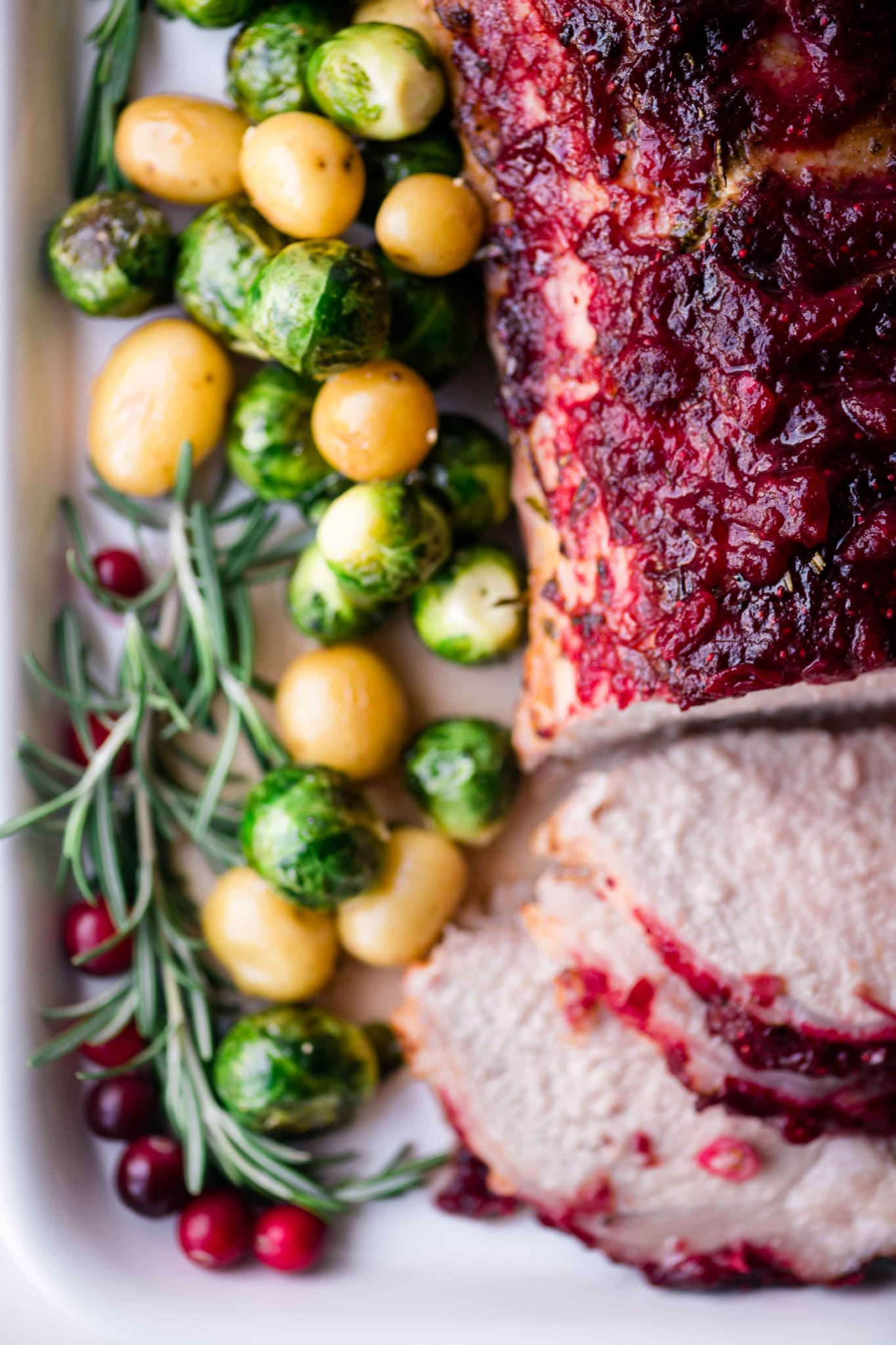 cranberry glazed pork roast with roasted potatoes and Brussels sprouts