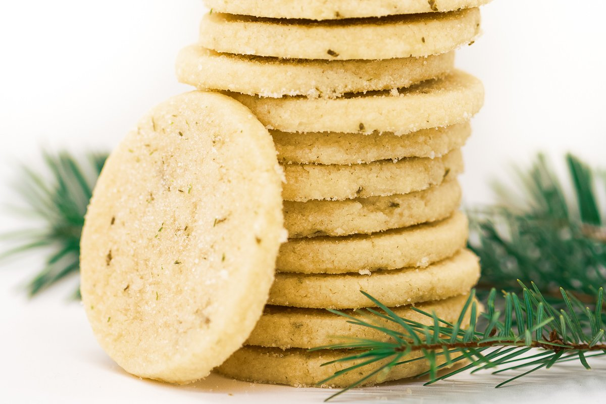 a stack of fir shortbread cookies with an evergreen sprig