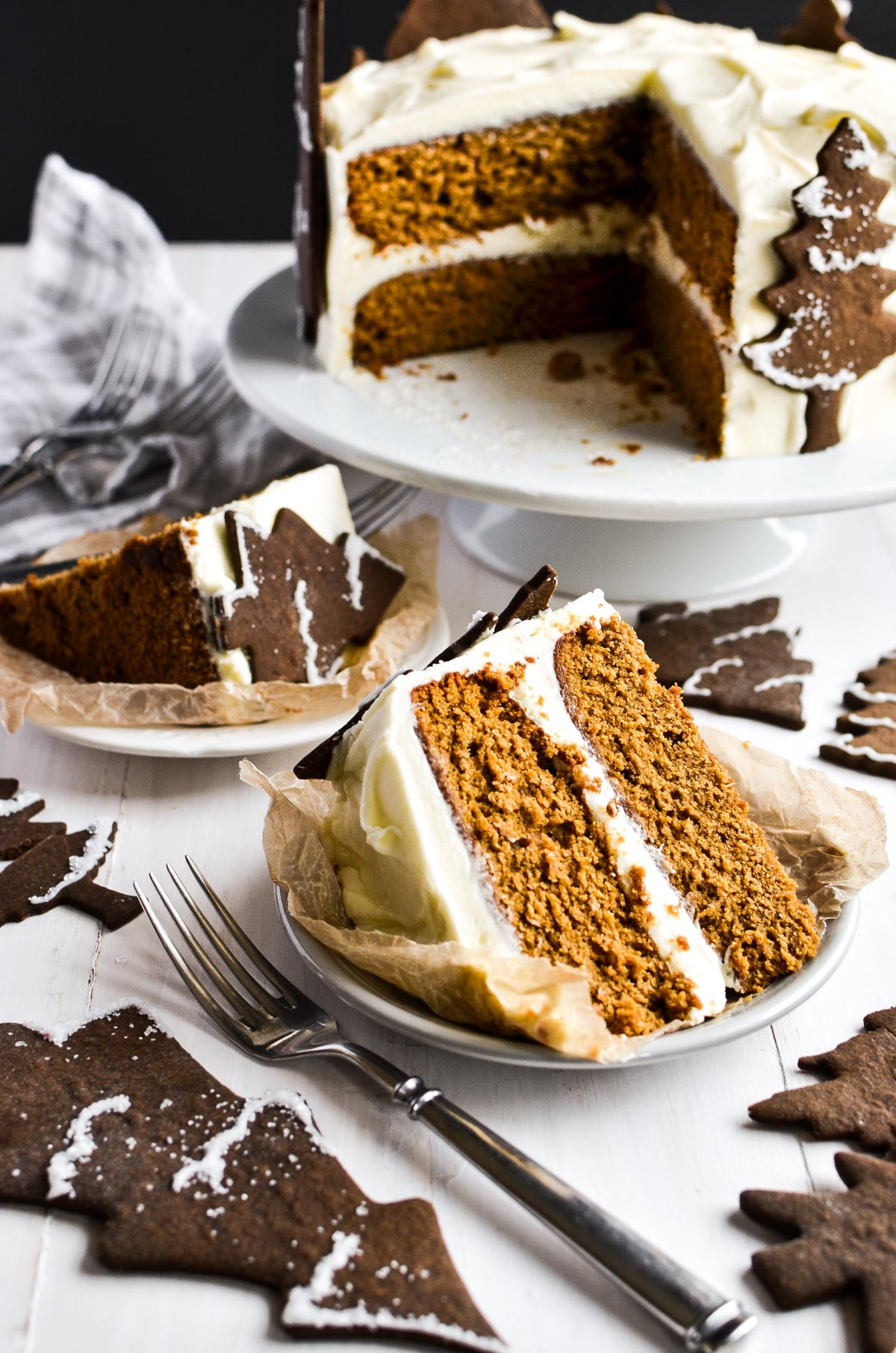 A piece of cake on a plate, with gingerbread