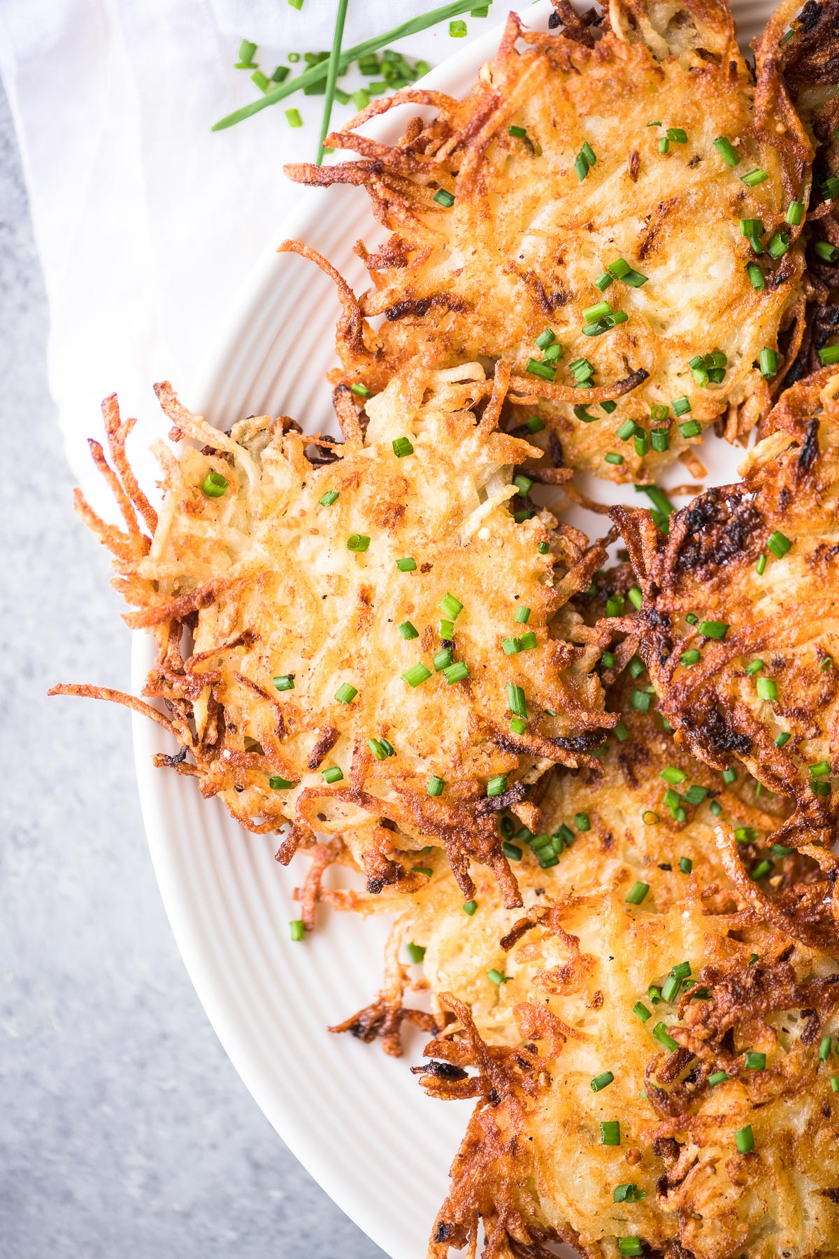 Extra crispy potato latkes on a plate