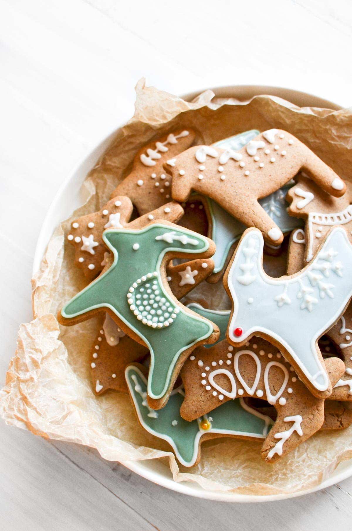 A bowl of decorated Pepparkakor Cookies.