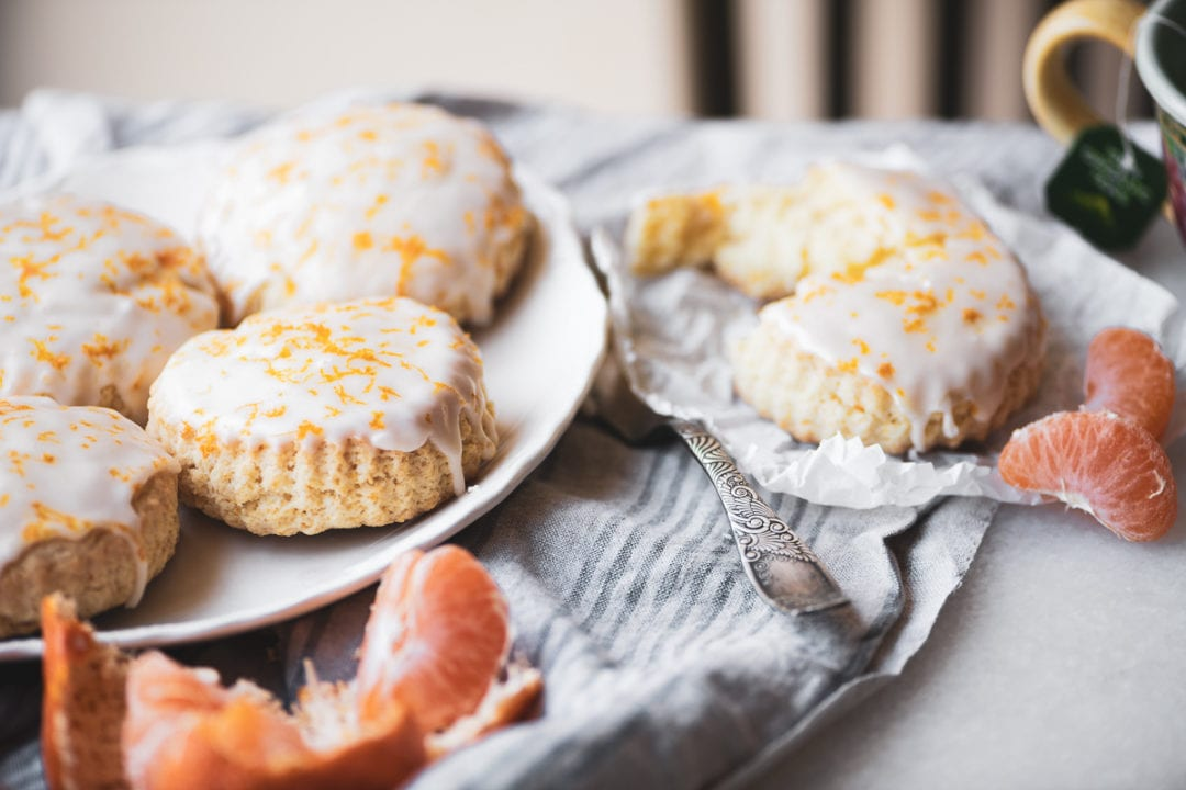 tangerine scones on a table with fresh tangerines