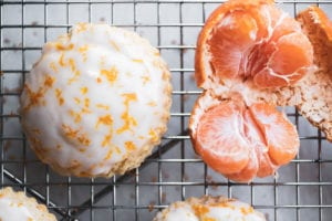tangerine scone with an unpeeled tangerine