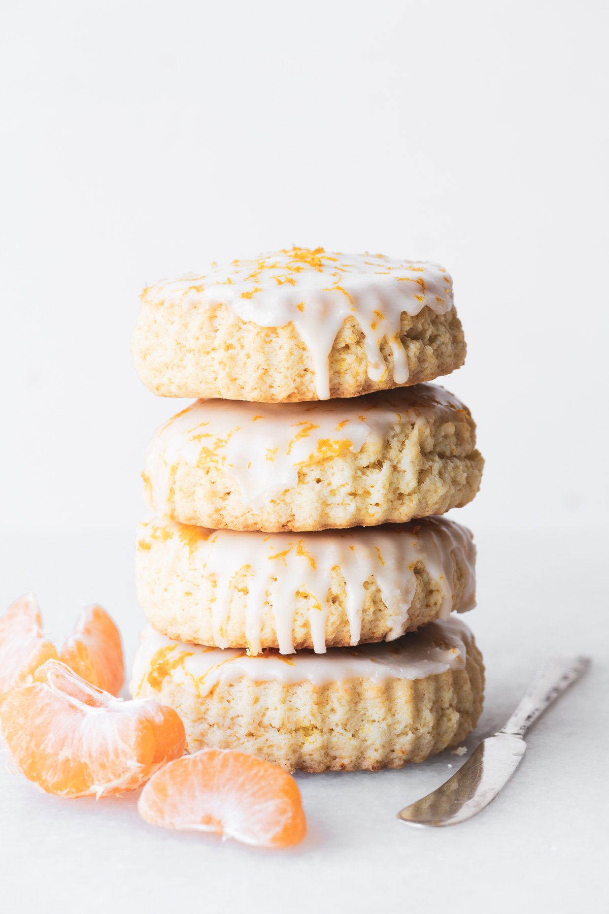 a stack of fresh tangerine scones with tangerine segments