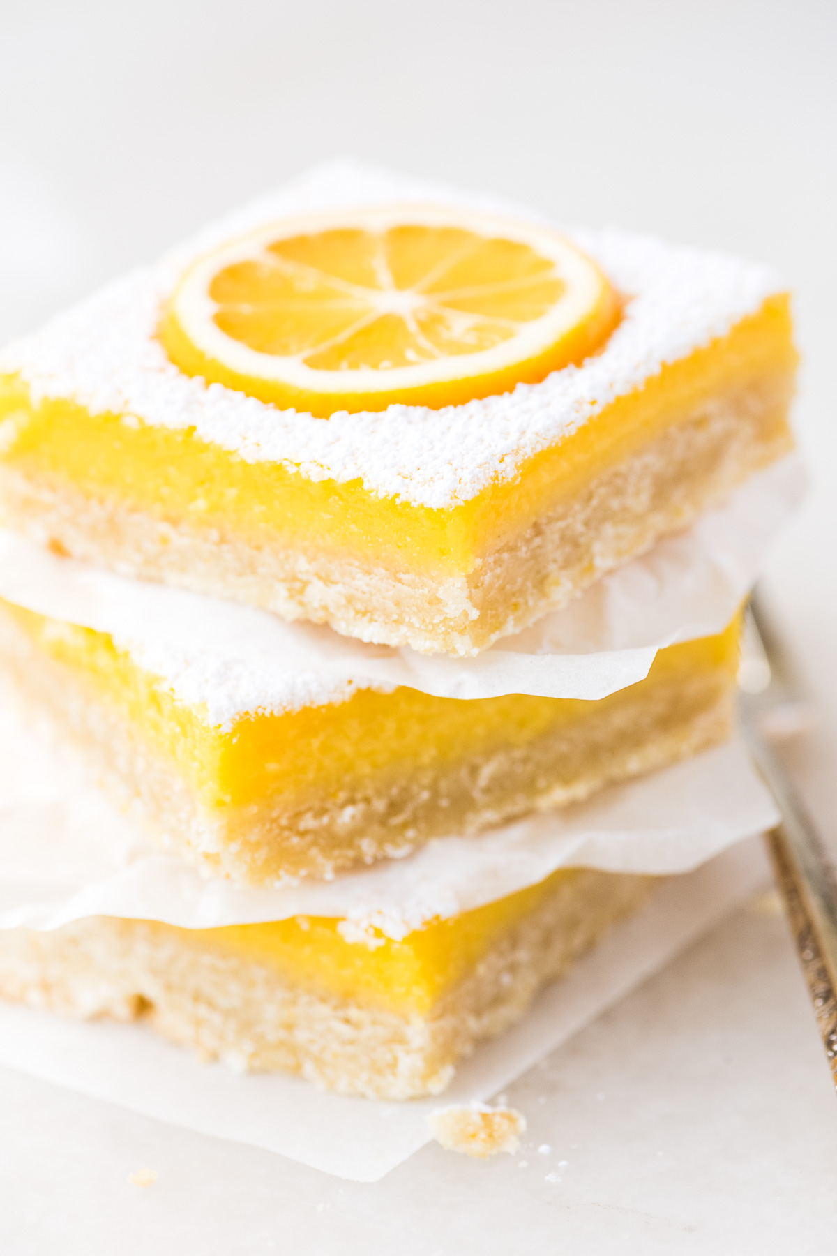 a stack of three Whole Meyer Lemon Bars