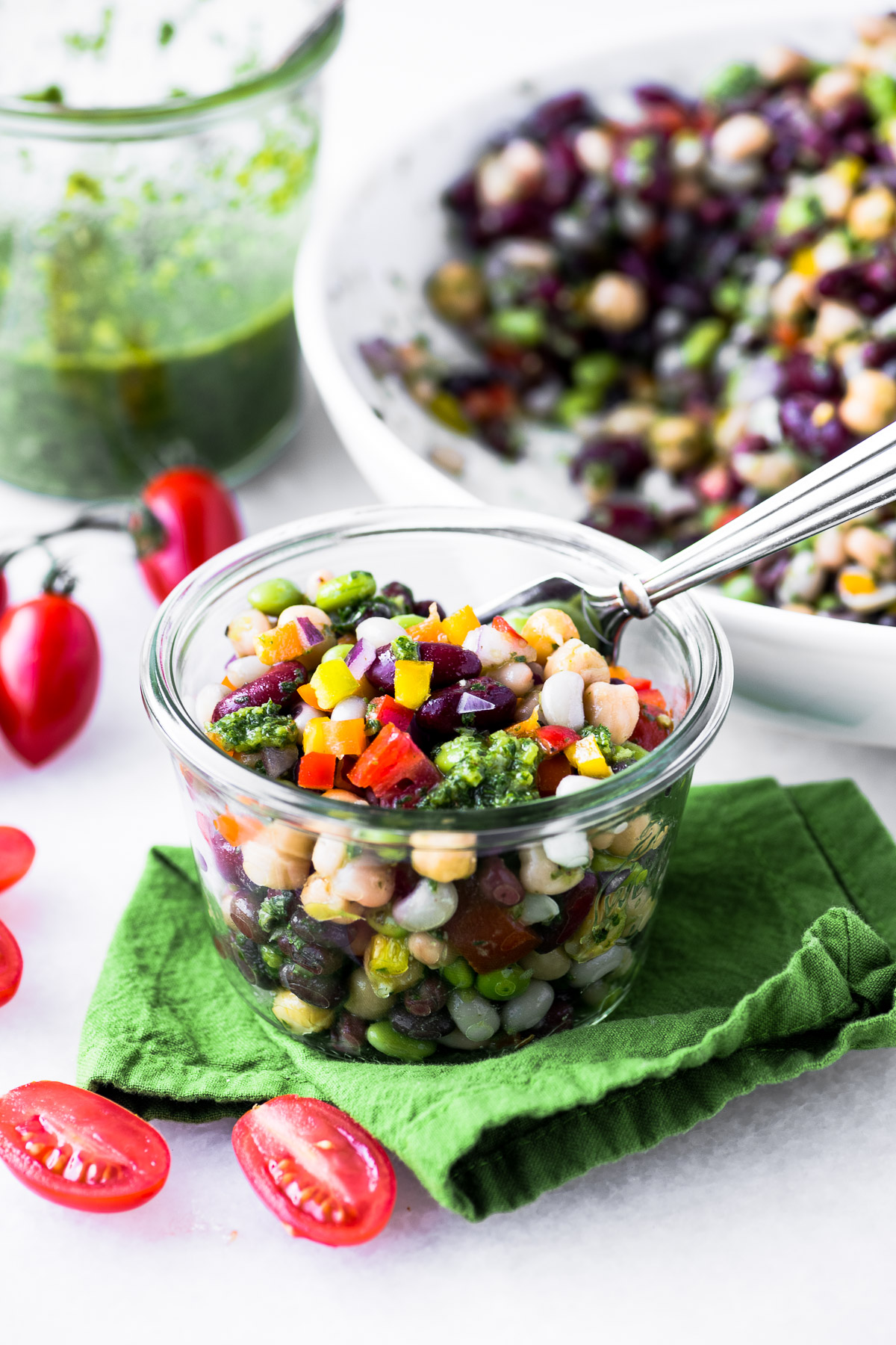 7 bean salad with chimichurri dressing in a small jar with fork