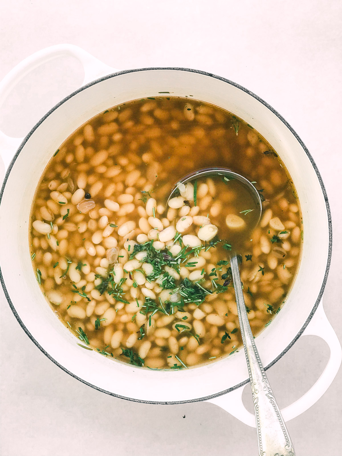 Great Northern beans cooked in an aromatic broth