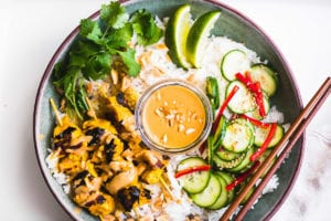 a chicken satay bowl with peanut sauce