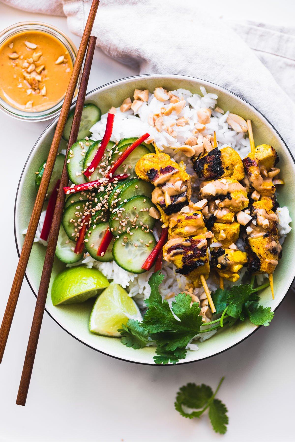 chicken satay bowl with chopsticks