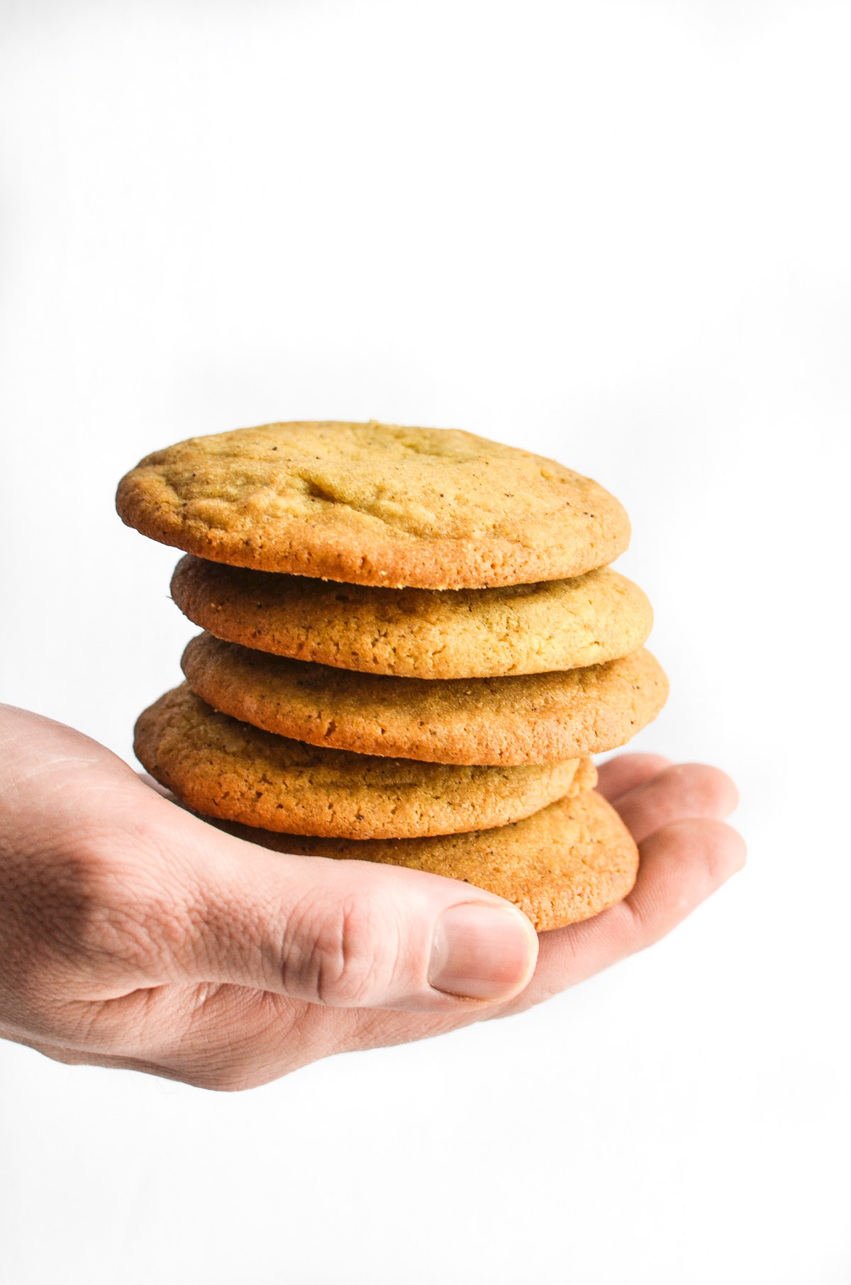 hand holding stack of chipless chocolate chip cookies