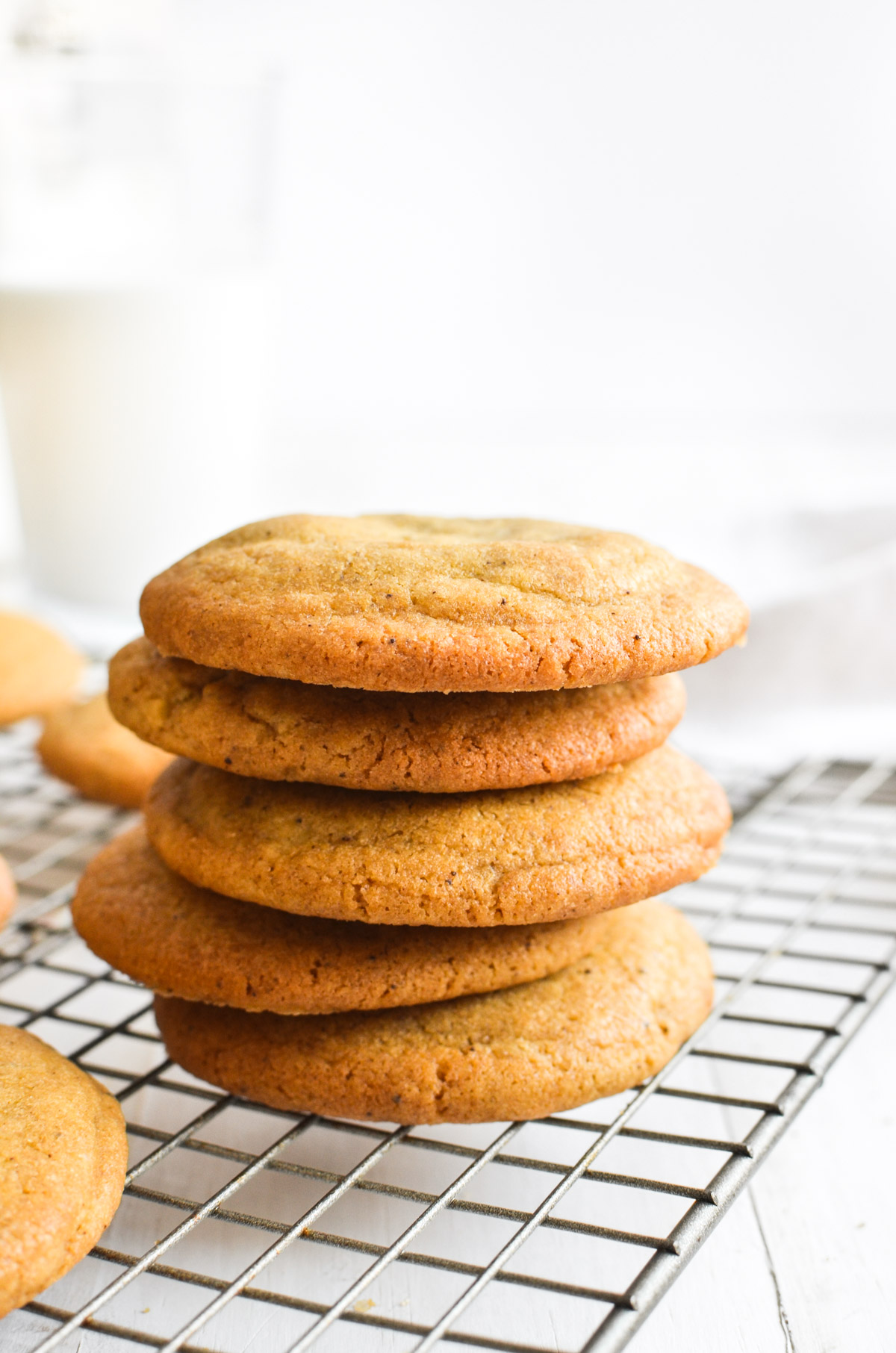 a stack of chipless chocolate chip cookies on a cooling rack