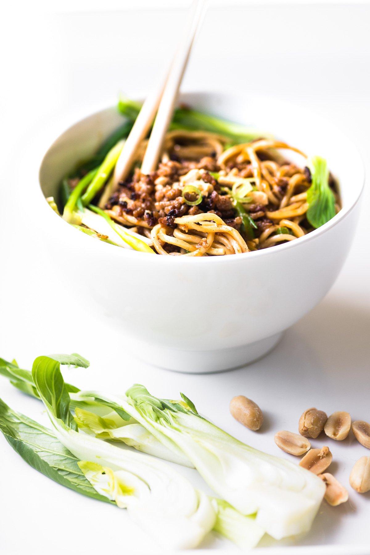 Dan dan noodle bowl with baby bok choy and peanuts