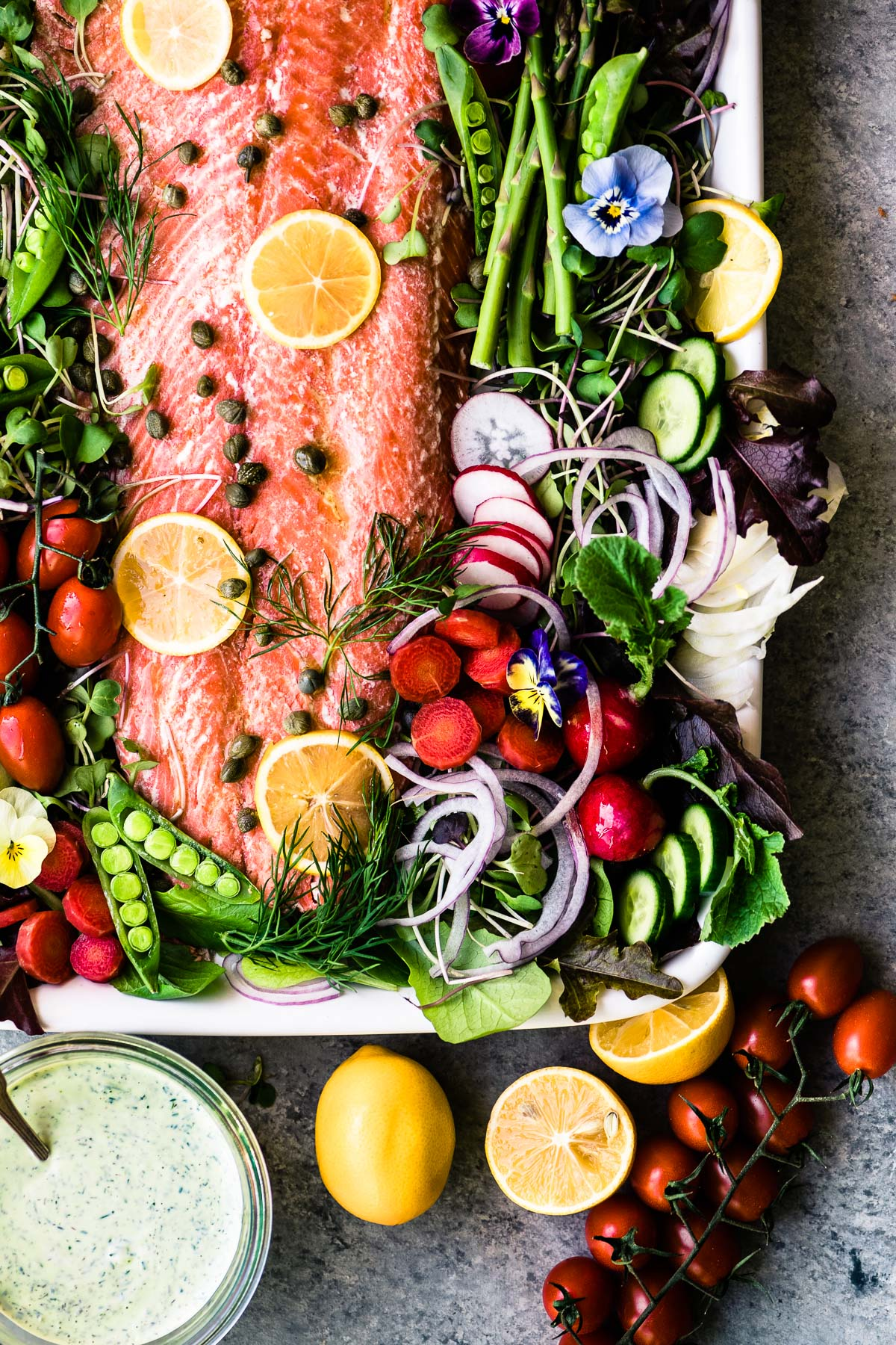 spring salmon salad on a platter with yogurt dill dressing