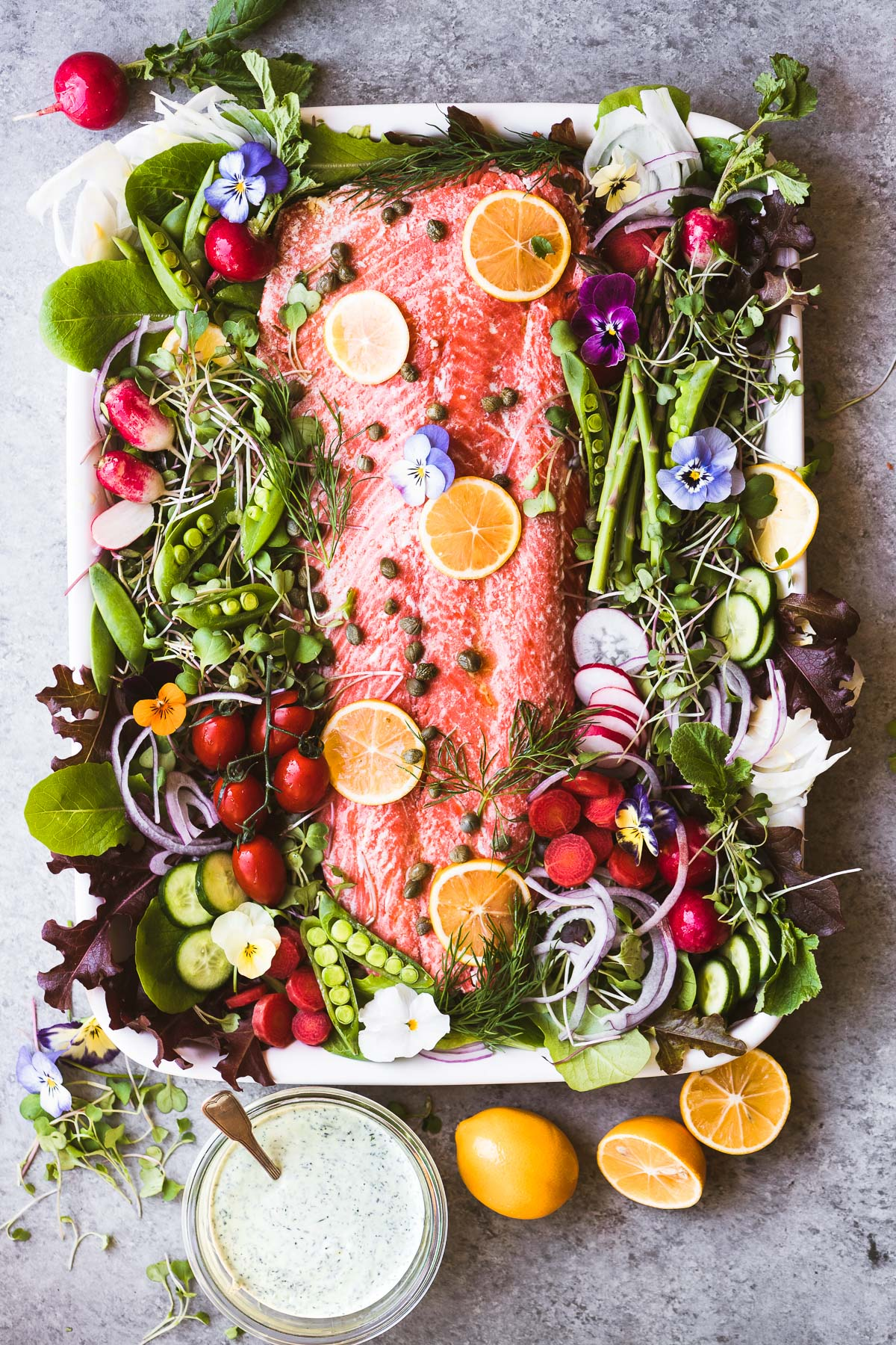 spring salmon salad platter on a white plate