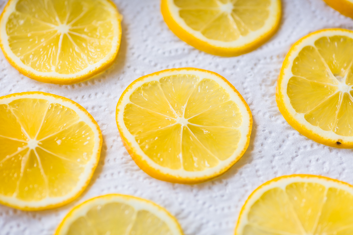 slices of Meyer lemon on a paper towel