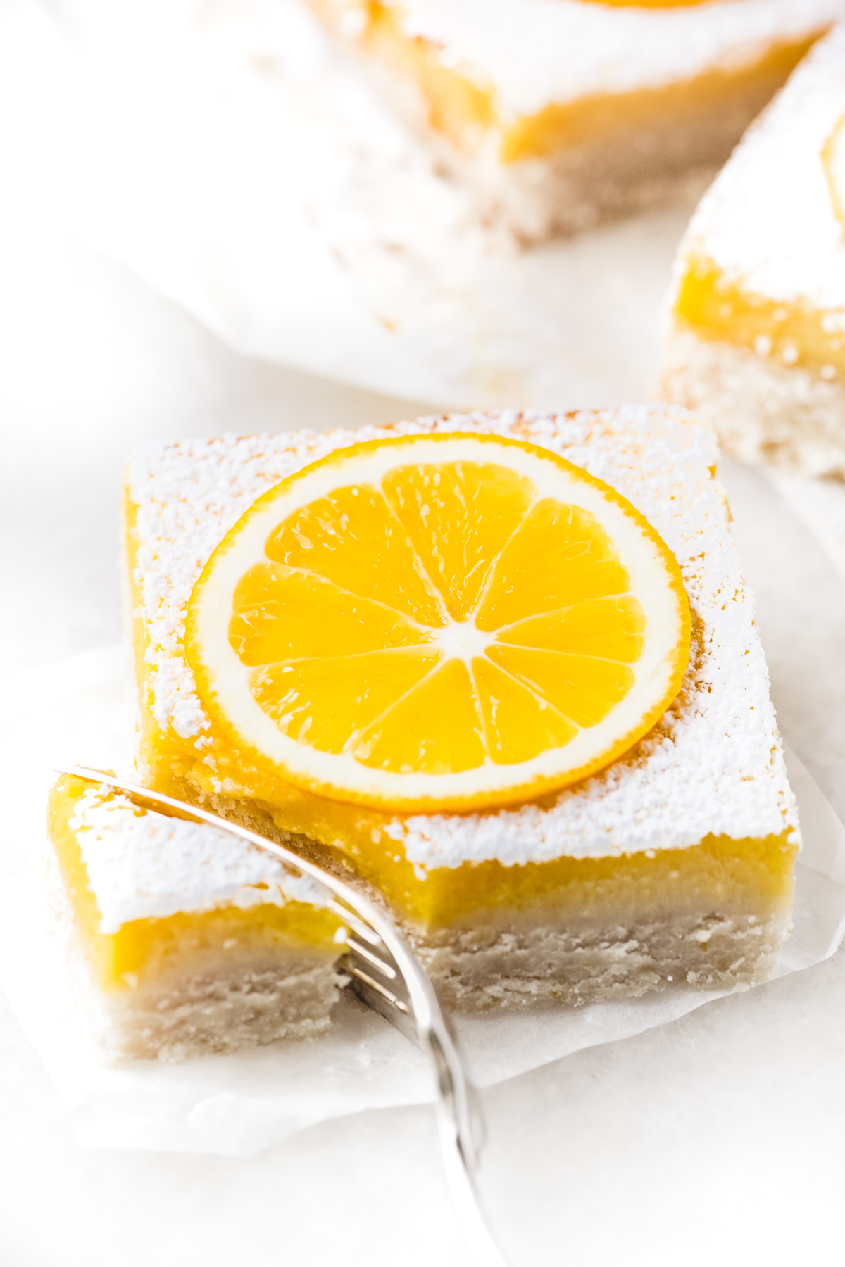 taking a bite of a Meyer Lemon Bar with a fork