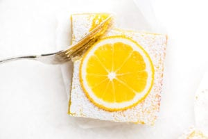 taking a bite of a Whole Meyer Lemon Bar